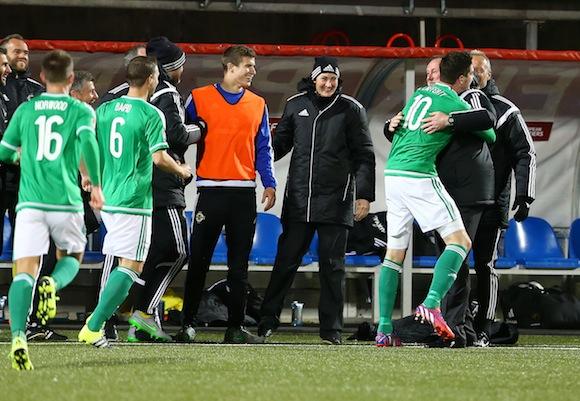 Guinness PRO12, Kingspan Stadium, Belfast 4/9/2015 Ulster vs Ospreys Northern Ireland's Kyle Lafferty celebrates scoring with manager Michael O'Neill Mandatory Credit ©INPHO/Presseye/Darren Kidd